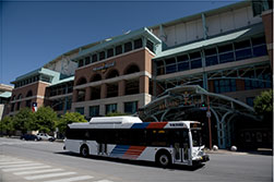 Discover Houston bus driving by Minute Maid Park