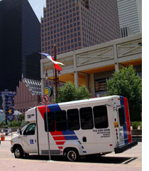 METROLift bus picking up passenger in downtown Houston